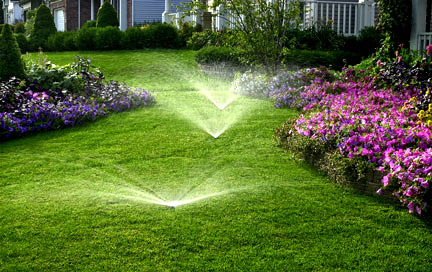 Three sprinkler heads spraying a beautiful green lawn after our Colorado Springs sprinkler Startup package